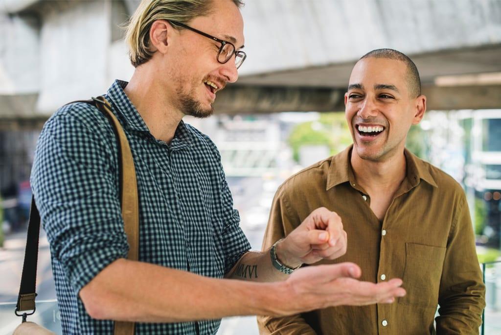 Two men talking enthusiastically