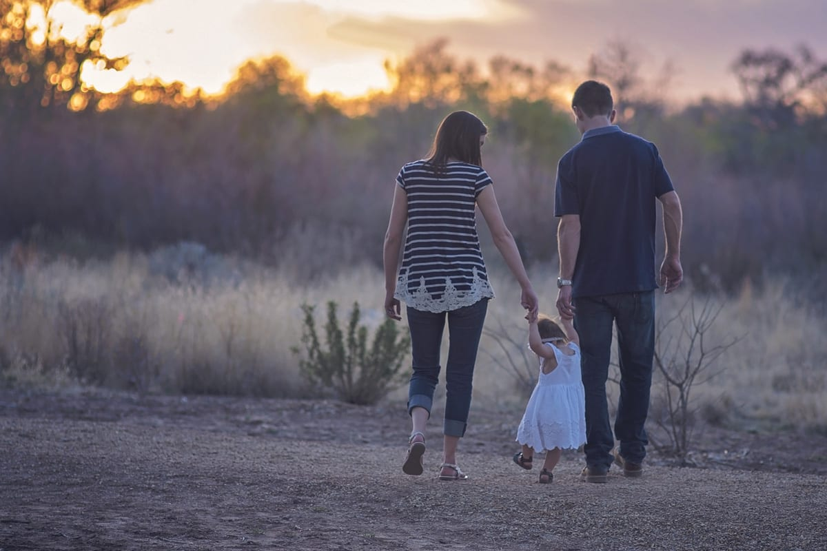 Photo of Parents with small girl walking at sunset, Di Beard Personal Coaching