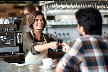 engaged customer, barista talking with customer, business coaching
