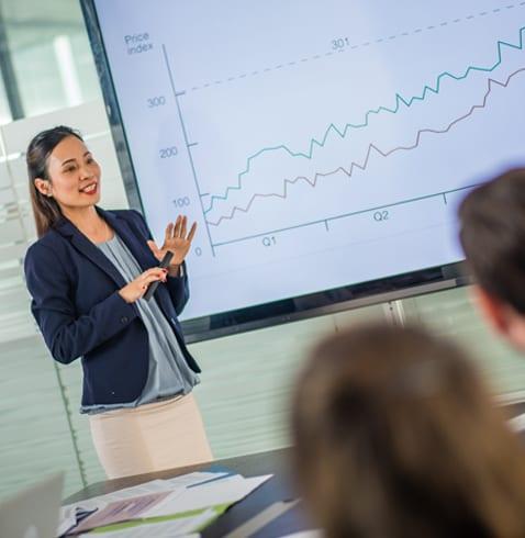 businesswoman giving a profitability report presentation, business coaching