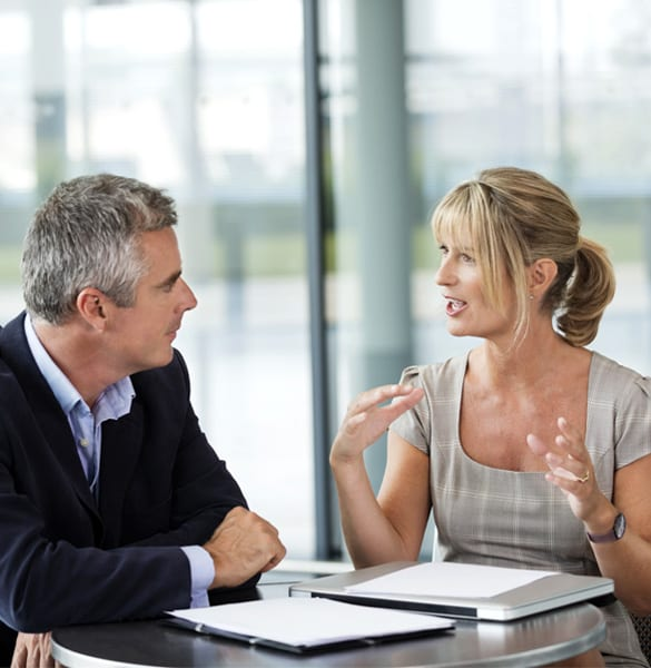 executive business coach talking to and coaching a male individual