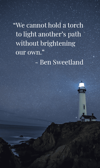 Lighthouse at night with inspirational quote